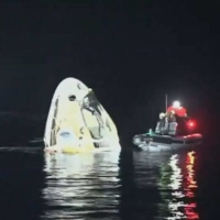 The Crew Dragon capsule splashed down at 2:56 a.m. Sunday off the coast of Florida. | NASA TV / VIA KYODO
