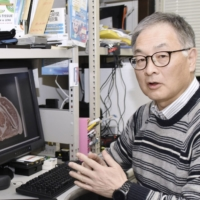 Keigo Kuchida, a professor at Obihiro University of Agriculture and Veterinary Medicine, explains his research in Obihiro, Hokkaido, on March 30. | KYODO