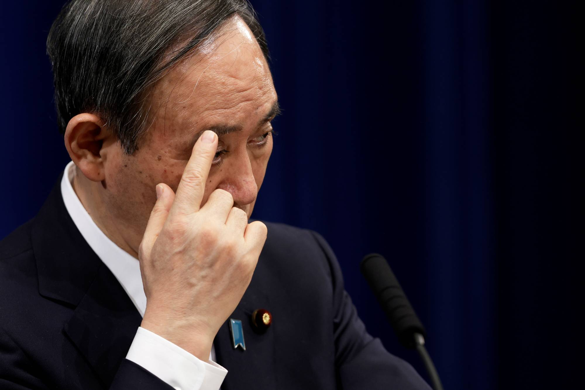 Prime Minister Yoshihide Suga holds a news conference in Tokyo on Jan. 7. | POOL / VIA REUTERS