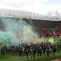 Manchester United match postponed after fans storm pitch to protest club's owners
