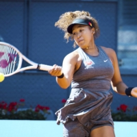 Naomi Osaka hits a return against Karolina Muchova during the second round of the Madrid Open on Sunday. | KYODO
