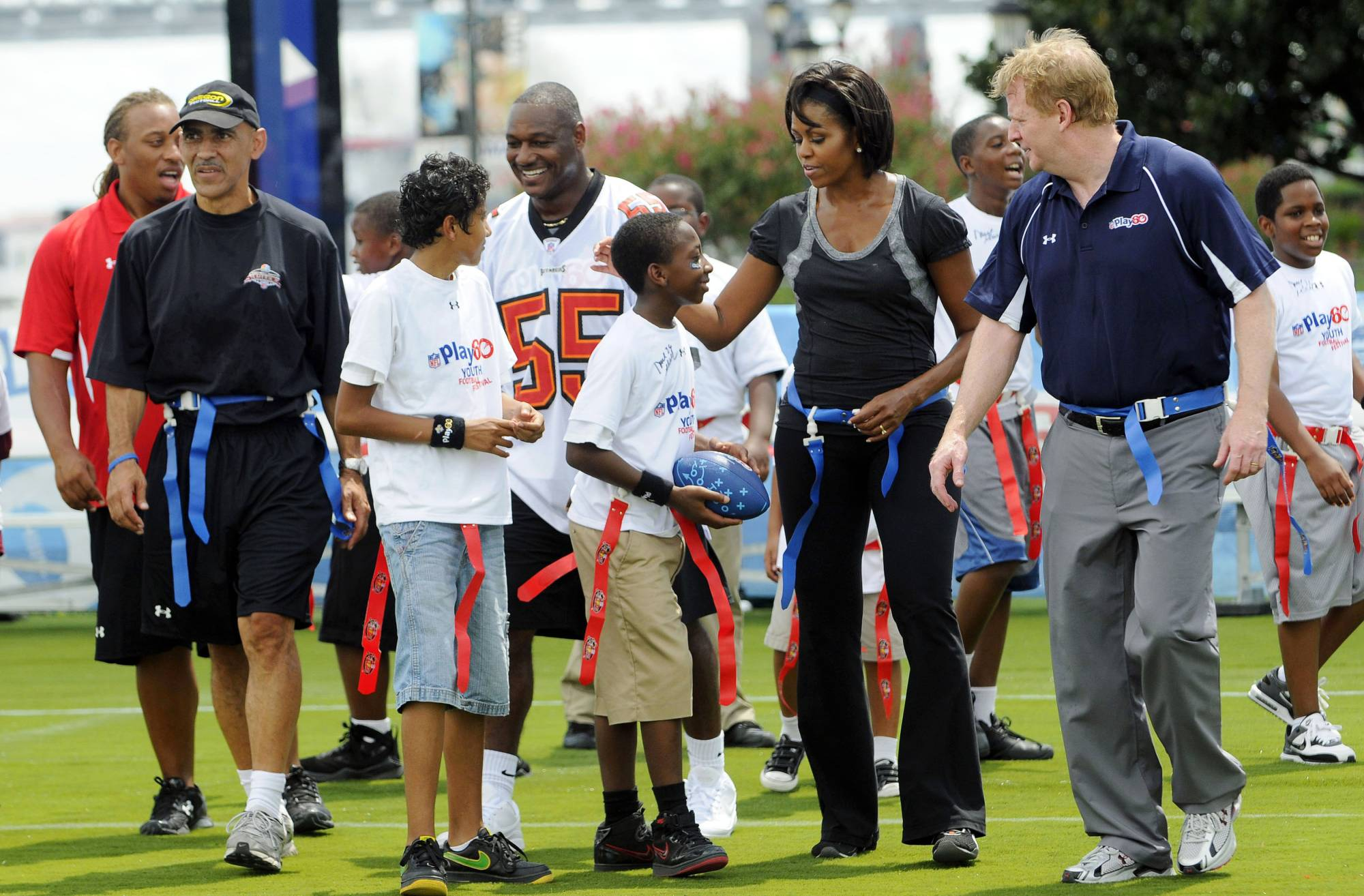 U.S. first lady Michelle Obama (second from right) participates in a flag football event with former NFL coach Tony Dungy (second from left), and NFL Commissioner Roger Goodell (right) as part of her campaign to fight child obesity on Sept. 8, 2018, in New Orleans. | REUTERS