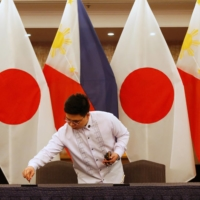 An official prepares for a media briefing during a meeting between Foreign Minister Toshimitsu Motegi and Philippine Foreign Affairs Secretary Teodoro Locsin Jr. in Manila in January 2020.