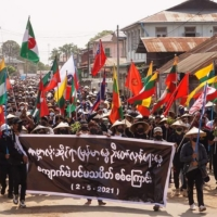 People demonstrate against the military coup, in Kyaukme, Myanmar, on Sunday. | SHWE PHEE MYAY NEWS AGENCY / VIA AFP-JIJI