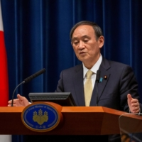 Prime Minister Yoshihide Suga speaks during a news conference on COVID-19 situation, in Tokyo on April 23. | POOL / VIA REUTERS