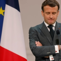 French President Emmanuel Macron delivers a speech in Paris on Saturday.  | POOL / VIA REUTERS