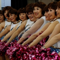 Members of cheer squad Japan Pom Pom post for commemorative photos before filming a dance routine for an online performance in Tokyo, Japan, April 12.