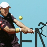 Kei Nishikori hits a return against Alexander Zverev during the second round of the Madrid Open on Wednesday. | KYODO