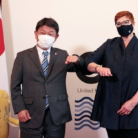Foreign Minister Toshimitsu Motegi meets with his Australian counterpart, Marise Payne, at the G7 foreign ministers meeting in London on May 5. | POOL / VIA AFP-JIJI