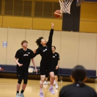 Point guard Nako Motohashi goes up for a layup during a practice for the provisional Japan women's national team at Tokyo's National Training Center on Thursday. | JAPAN BASKETBALL ASSOCIATION