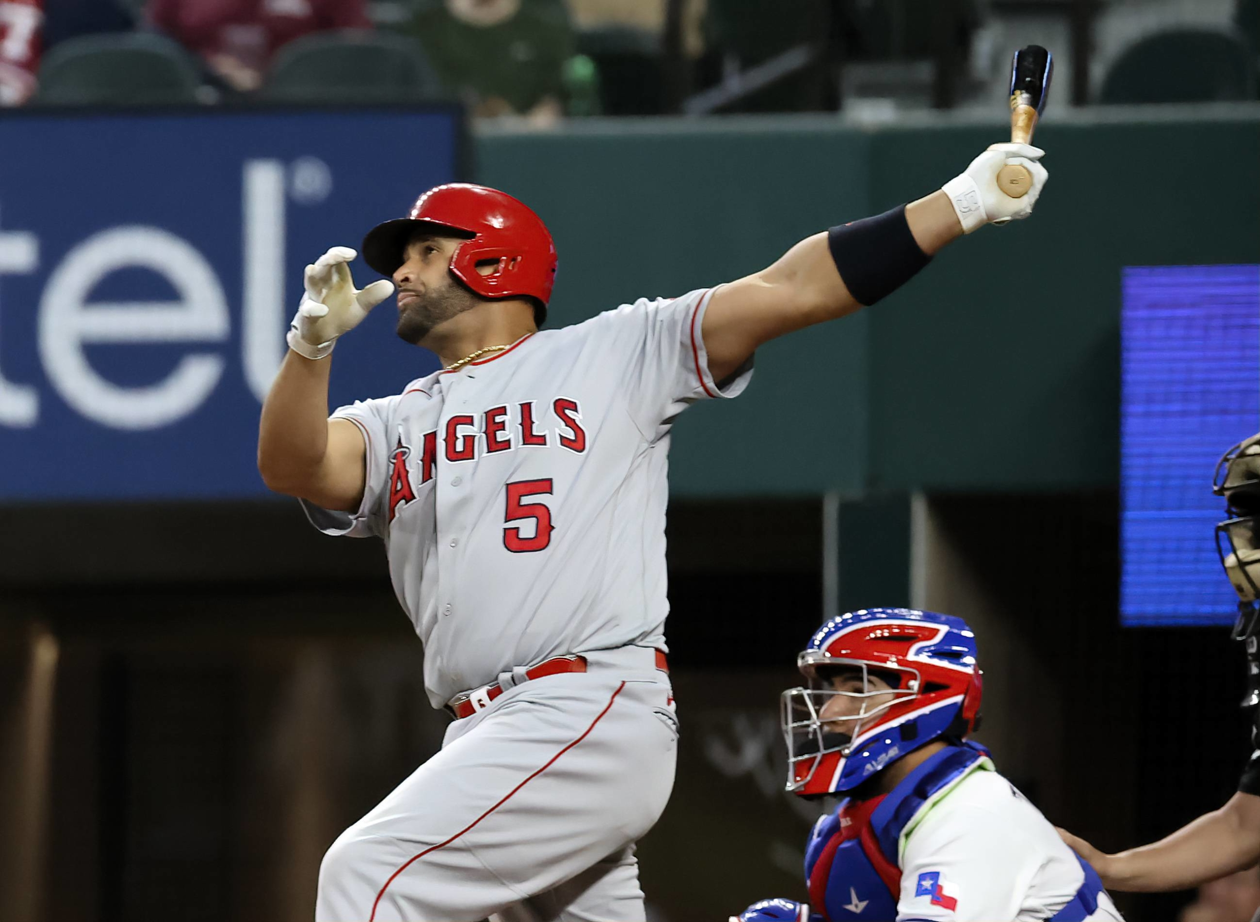 Angels first baseman Albert Pujols hits a home run against the Rangers during the fourth inning in Arlington, Texas, on April 26. | USA TODAY / VIA REUTERS