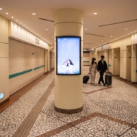 People walk inside a closed shopping mall at JR Shimbashi Station in Tokyo on Tuesday. | AFP-JIJI