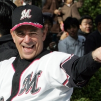 Then-Chiba Lotte Marines manager Bobby Valentine gestures during a victory parade in the city of Chiba in November 2005 after the Marines won the Asia Series. | REUTERS