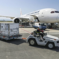 A container holding Moderna Inc.'s coronavirus vaccine is off-loaded after arriving at Kansai Airport in Osaka Prefecture, on April 30.