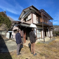 Imagining the future: Matthew Ketchum of Akiya and Inaka, a company focused on helping non-Japanese residents find  empty homes in the countryside, shows a client a building in Kanagawa Prefecture in January.