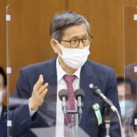 Japan coronavirus panel chief warns against ending emergency too soon