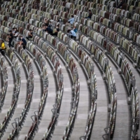 Empty seats are seen during  race test event for the 2020 Tokyo Olympics at the National Stadium in Tokyo on Sunday   AFP-JIJI