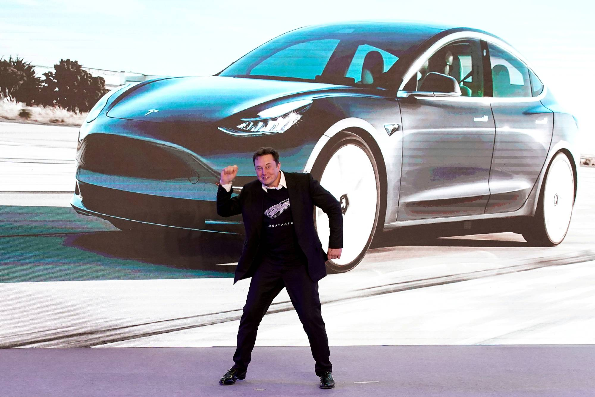 Tesla Inc. CEO Elon Musk dances onstage during a delivery event for Tesla's China-made Model 3 cars in Shanghai in January 2020. | REUTERS