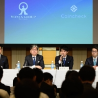 Coincheck Inc. executive Yusuke Otsuka (right) attends a news conference along with then-CEO Koichiro Wada (second from right) and Monex Group Inc. executives in Tokyo in April 2018 to announce the acquisition of Coincheck by Monex. | BLOOMBERG
