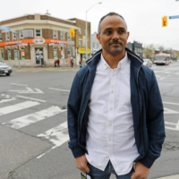 Yohannes Abraha, an ethnic Tigrayan and former director of southern and western European affairs at Ethiopia's Ministry of Foreign Affairs, poses for a photo in Toronto on May 4.   REUTERS