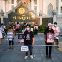 The mothers of arrested anti-government protest leaders demand the release of their sons outside Remand prison in Bangkok on April 28.  | REUTERS