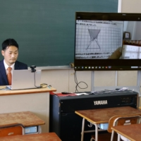 An elementary school teacher holds an online class in the city of Osaka in April. | KYODO