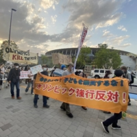 Protestor march during a demonstration against the 2020 Olympics in Tokyo on Sunday.   KAZ NAGATSUKA
