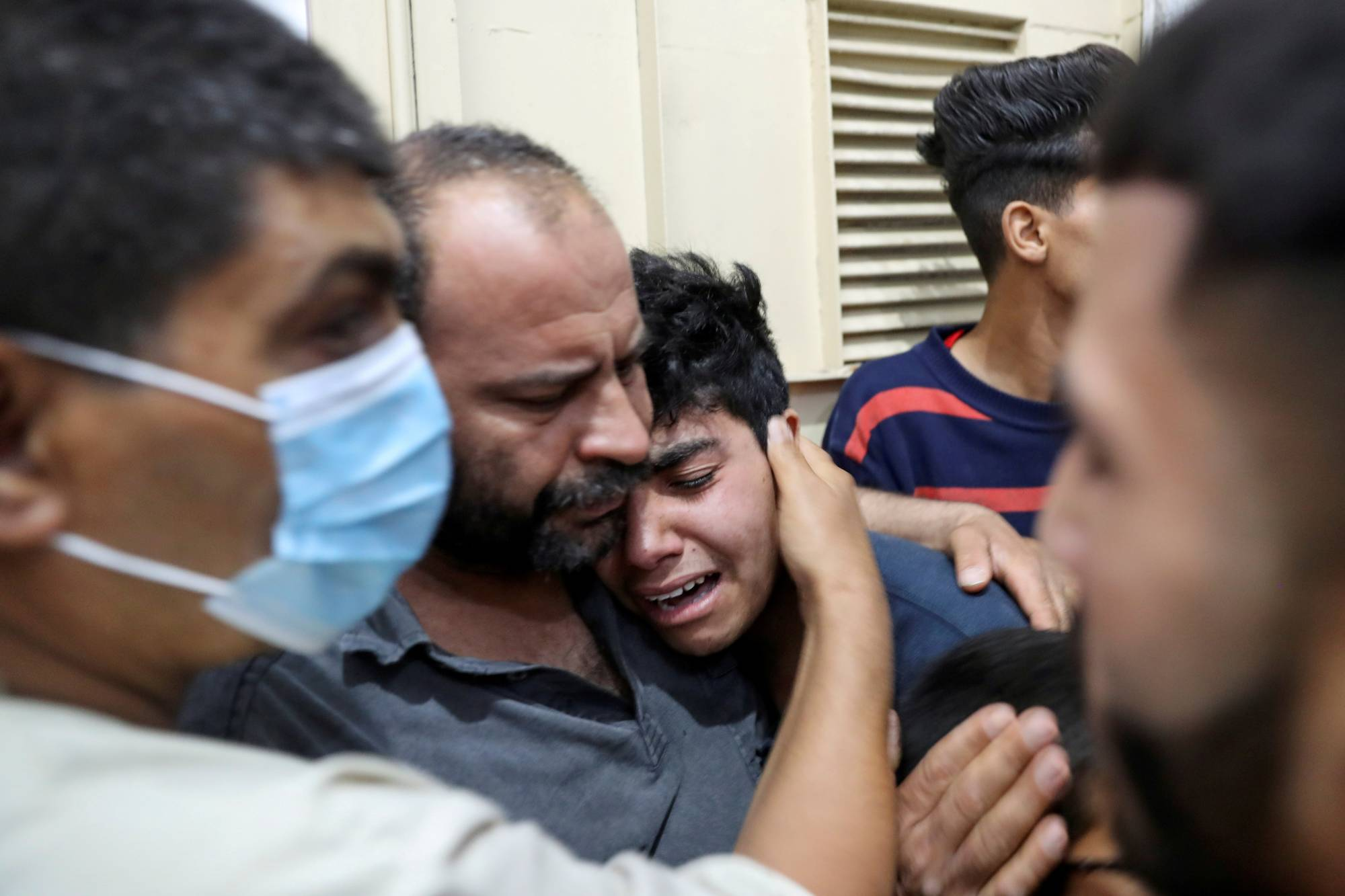 A relative of a Palestinian who was killed amid a flare-up of Israeli-Palestinian violence is comforted at a hospital in the northern Gaza Strip on Monday.   REUTERS