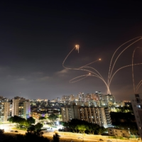 Streaks of light are seen as Israel's Iron Dome anti-missile system intercepts rockets launched from the Gaza Strip toward Israel.   REUTERS