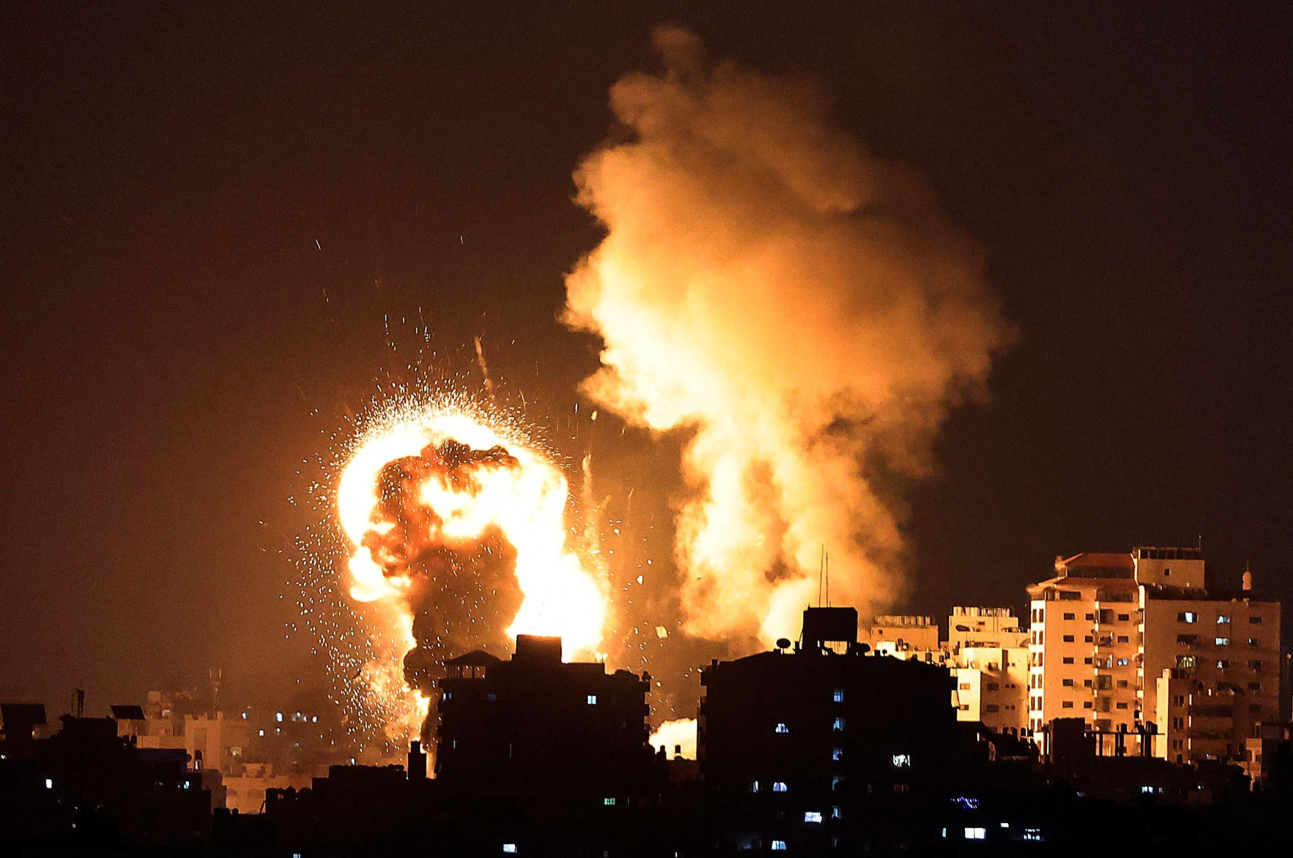 Flames rise from Israeli air strikes in the Gaza Strip on Monday.    AFP-JIJI