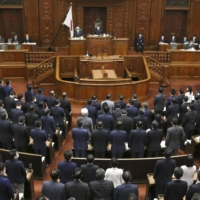 The Lower House passes the revised national referendum bill during its plenary session Tuesday.   KYODO