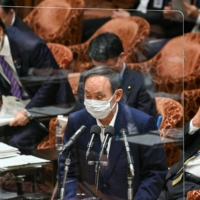 Prime Minister Yoshihide Suga is planning to attend a major security forum to be held in Singapore next month, government sources say. | AFP-JIJI