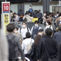 Tokyo reported 925 new cases of COVID-19 on Tuesday. | KYODO