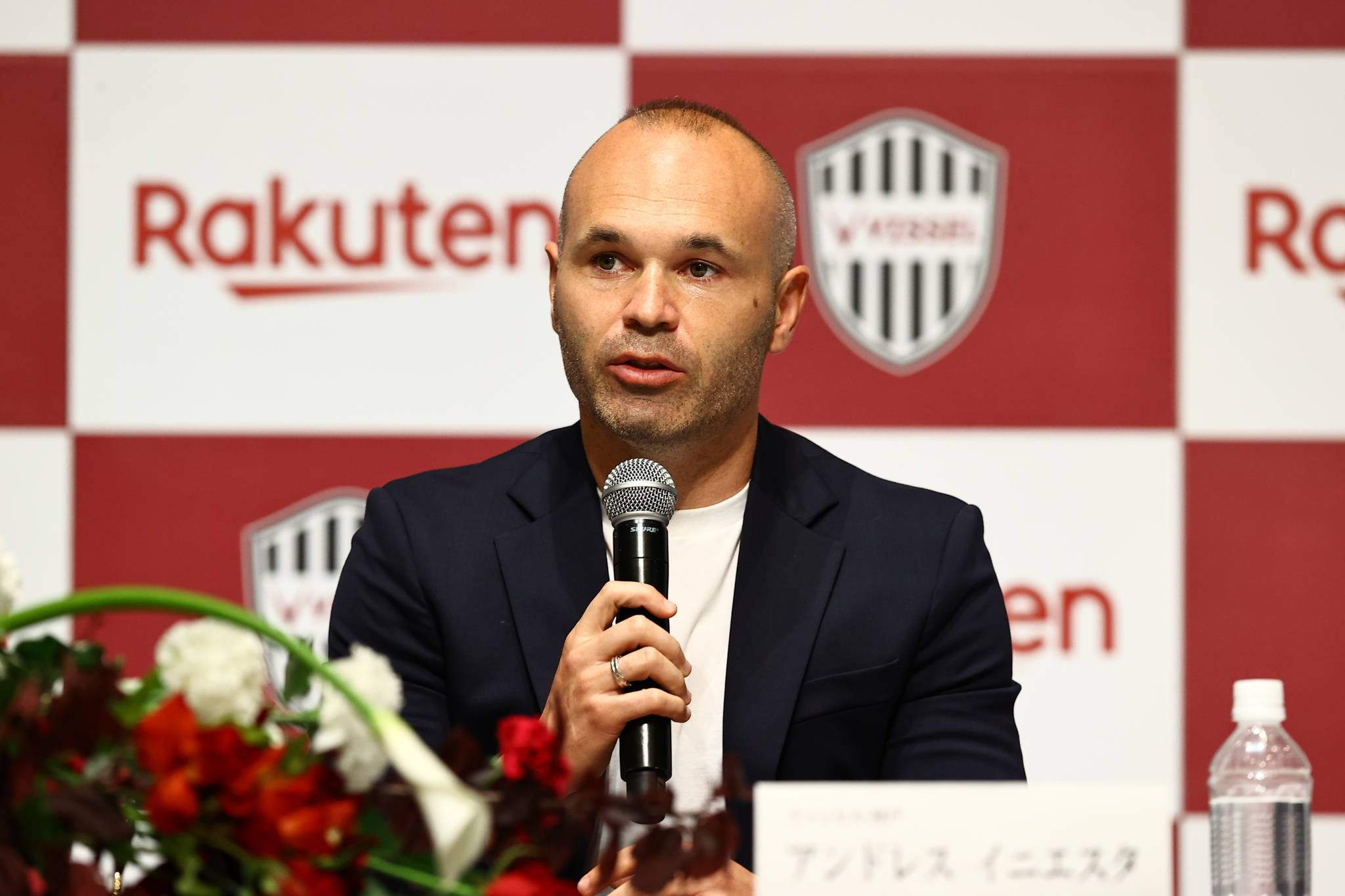 Vissel Kobe captain Andres Iniesta speaks during a news conference announcing his contract extension with the club on Tuesday. | VISSEL KOBE
