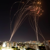 Streaks of light are seen as Israel's Iron Dome anti-missile system intercepts rockets launched from the Gaza Strip towards Israel, as seen from Ashkelon, Israel, May 11, 2021..