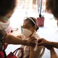 A woman receives a dose of Sinovac Biotech Ltd.'s COVID-19 vaccine on Tuesday in Quezon City, Philippines.
