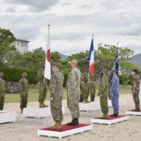 Forces from Japan, the United States, France and Australia attend an opening ceremony of a joint drill in Ground Self-Defense Force Camp Ainoura in Nagasaki Prefecture on Tuesday. | GROUND SELF-DEFENSE FORCE / VIA KYODO