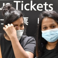 Two sisters of a Sri Lankan woman who died in March while being detained at the Nagoya Regional Immigration Services Bureau arrive at Narita Airport in Chiba Prefecture on May 1. | KYODO