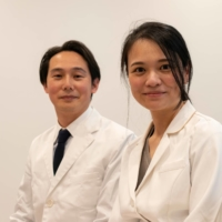 Clinic director Rie Mitsui and her husband, Toshikatsu, sit in the waiting room at Muza Kawasaki Pediatric Clinic in Kawasaki, Kanagawa Prefecture, in May. Toshikatsu, who was formerly a vaccine researcher at Keio University School of Medicine's pediatrics department, joined his wife after she opened the clinic in 2016. | ROB GILHOOLY