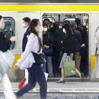 Scaled-back train services create congestion — and questions — in Japan