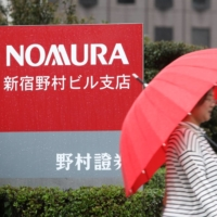 Nomura Holdings Inc. raised its pretax income target for the financial year ending March 2023 by 14% as it moves on from the implosion of Archegos Capital Management. | BLOOMBERG