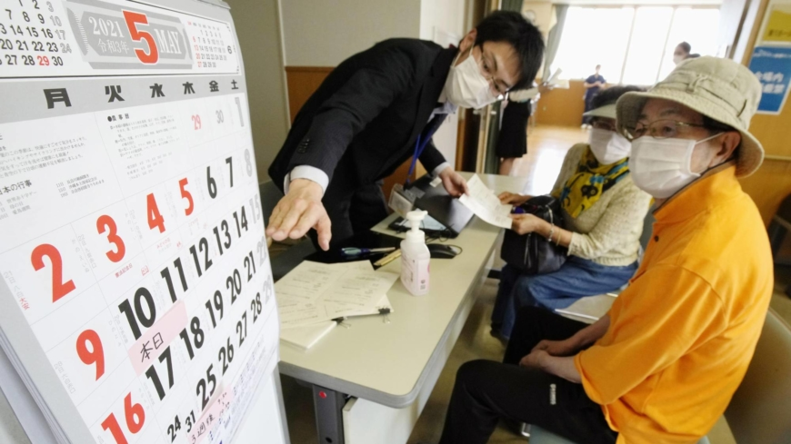 Confusion and hiccups as Japan ramps up vaccine rollout for older people