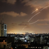 Rockets launched from the Gaza Strip, controlled by the Palestinian Hamas movement, are intercepted by Israel's Iron Dome aerial defense system on Wednesday.    AFP-JIJI