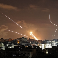Rockets are launched from Gaza City toward Israel on Wednesday.    AFP-JIJI