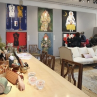 Visitors browse the private art collection of late Japanese fashion designer Kenzo Takada at auction operator Artcurial on Friday. | KYODO