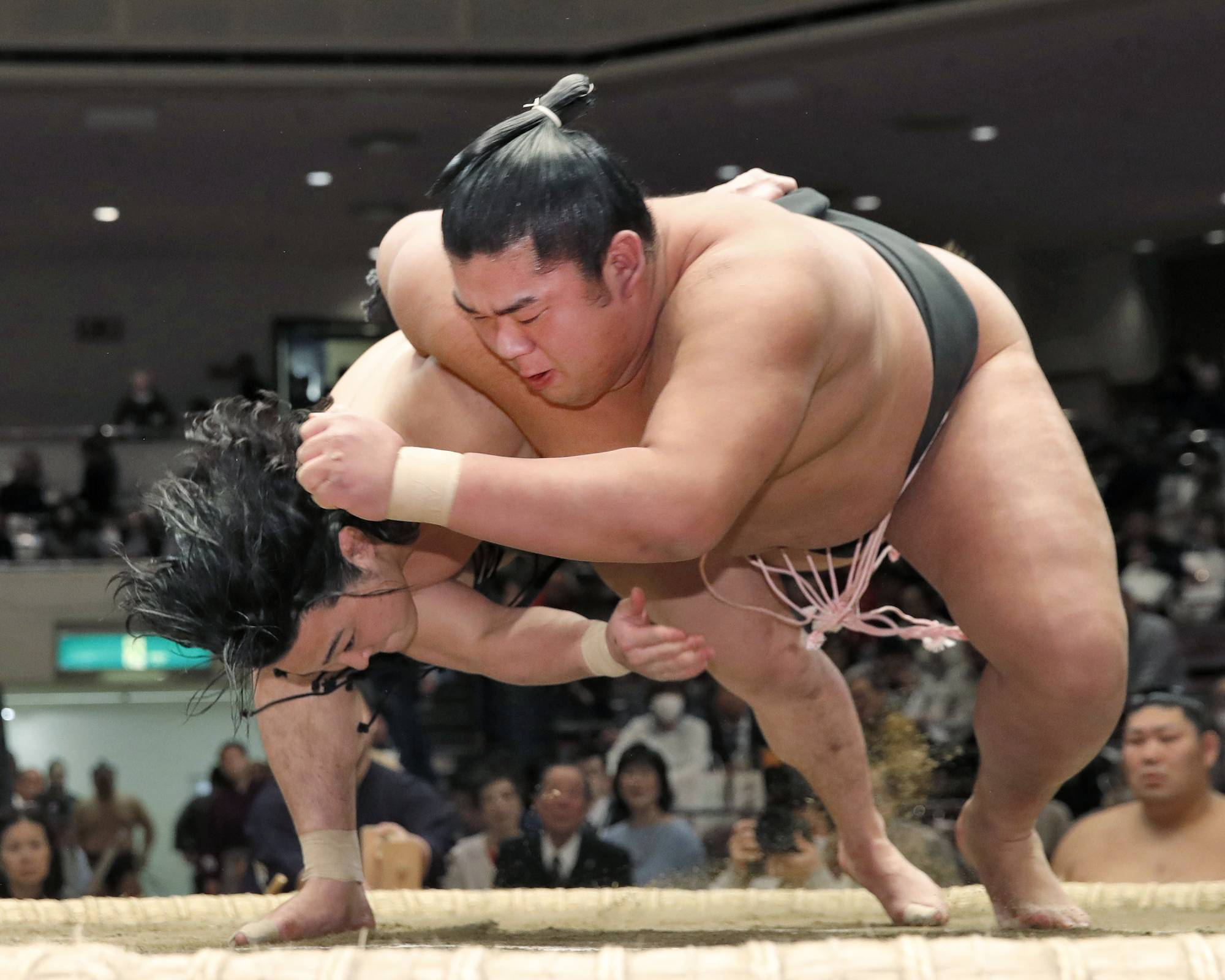Shonannoumi (right), seen during a bout on Jan. 26, 2018, suffered a concussion during this year's New Year Basho that sparked widespread calls for change. | KYODO