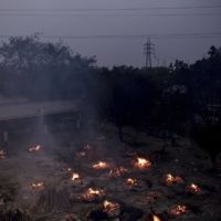 A mass cremation site in New Delhi on April 30 | BLOOMBERG