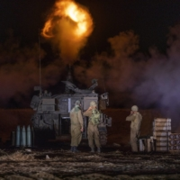 Israel and Palestinians exchange fire as violence escalates