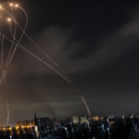 Rockets are launched toward Israel from the northern Gaza Strip on Friday. | HOSAM SALEM / THE NEW YORK TIMES