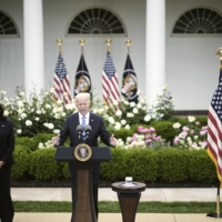 U.S. President Joe Biden, joined by Vice President Kamala Harris, speaks about update mask guidelines issued by the Centers for Disease Control and Prevention, at the White House on Thursday.  | T.J. KIRKPATRICK / THE NEW YORK TIMES